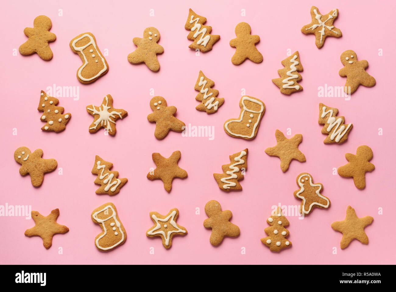 Homemade Christmas Cookies On Pink Background Pattern Of