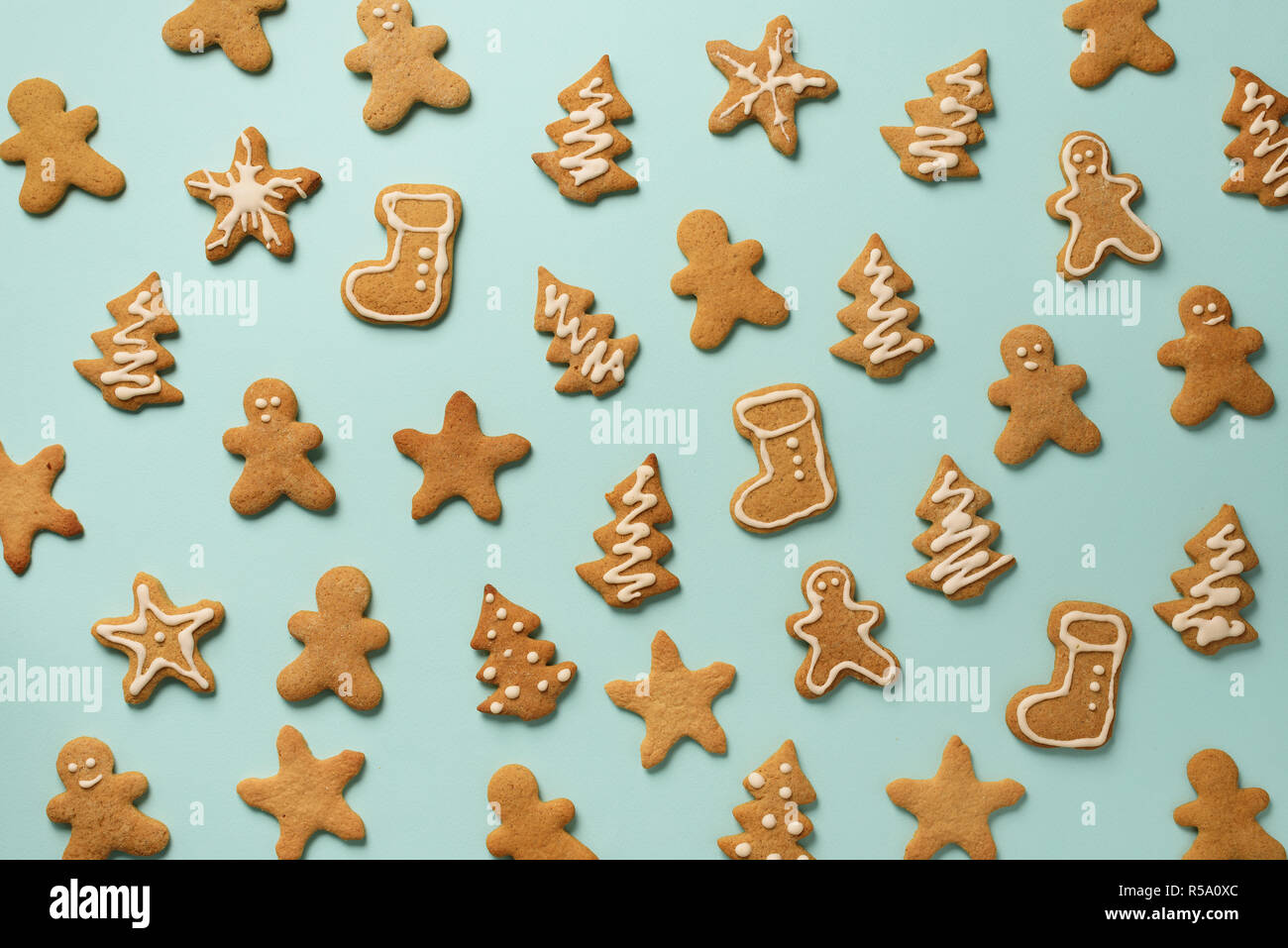 Homemade Christmas Cookies On Blue Background Pattern Of