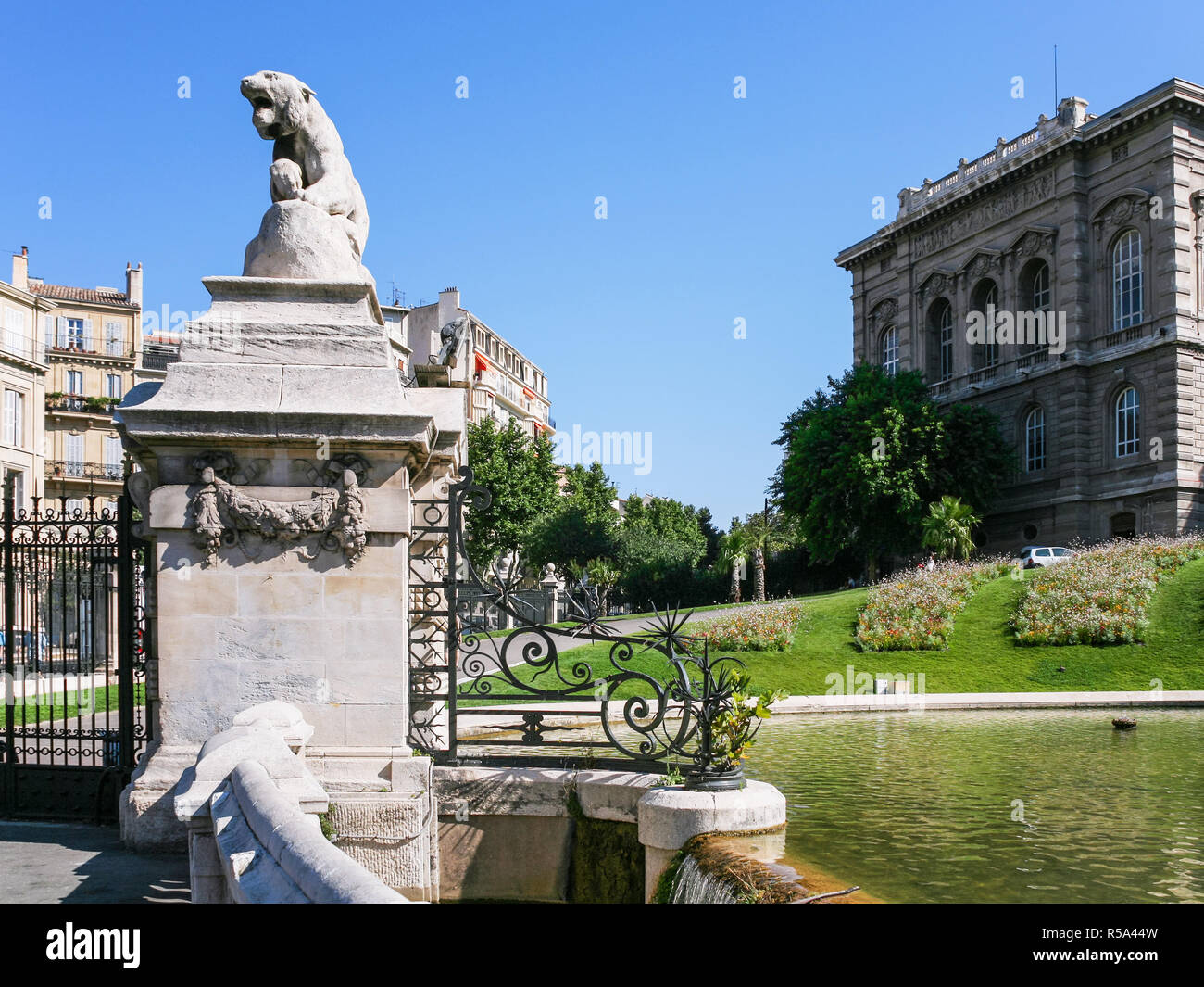Lion statue on gate of Palais Longchamp - Stock Image