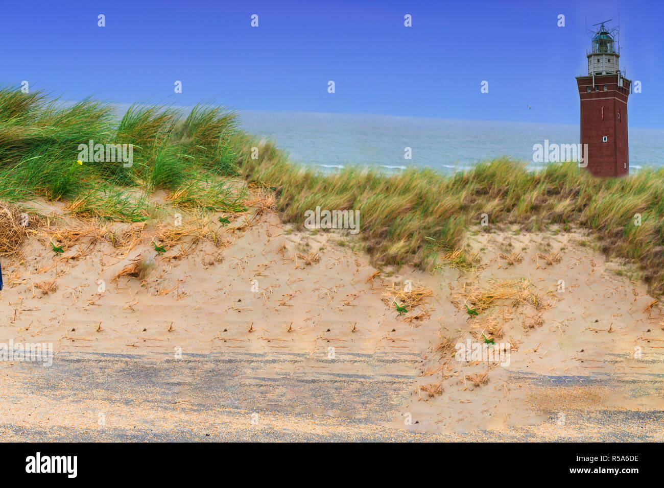 square lighthouse in the dunes - Stock Image
