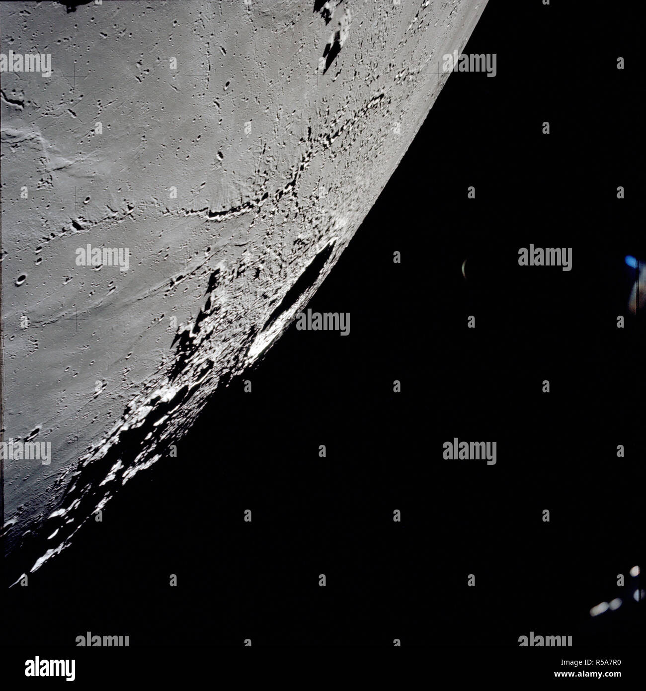 (7-19 Dec. 1972) --- An oblique view of the large crater Copernicus on the lunar nearside, as photographed from the Apollo 17 spacecraft in lunar orbit. This view is looking generally southwest toward the crater on the horizon. - Stock Image