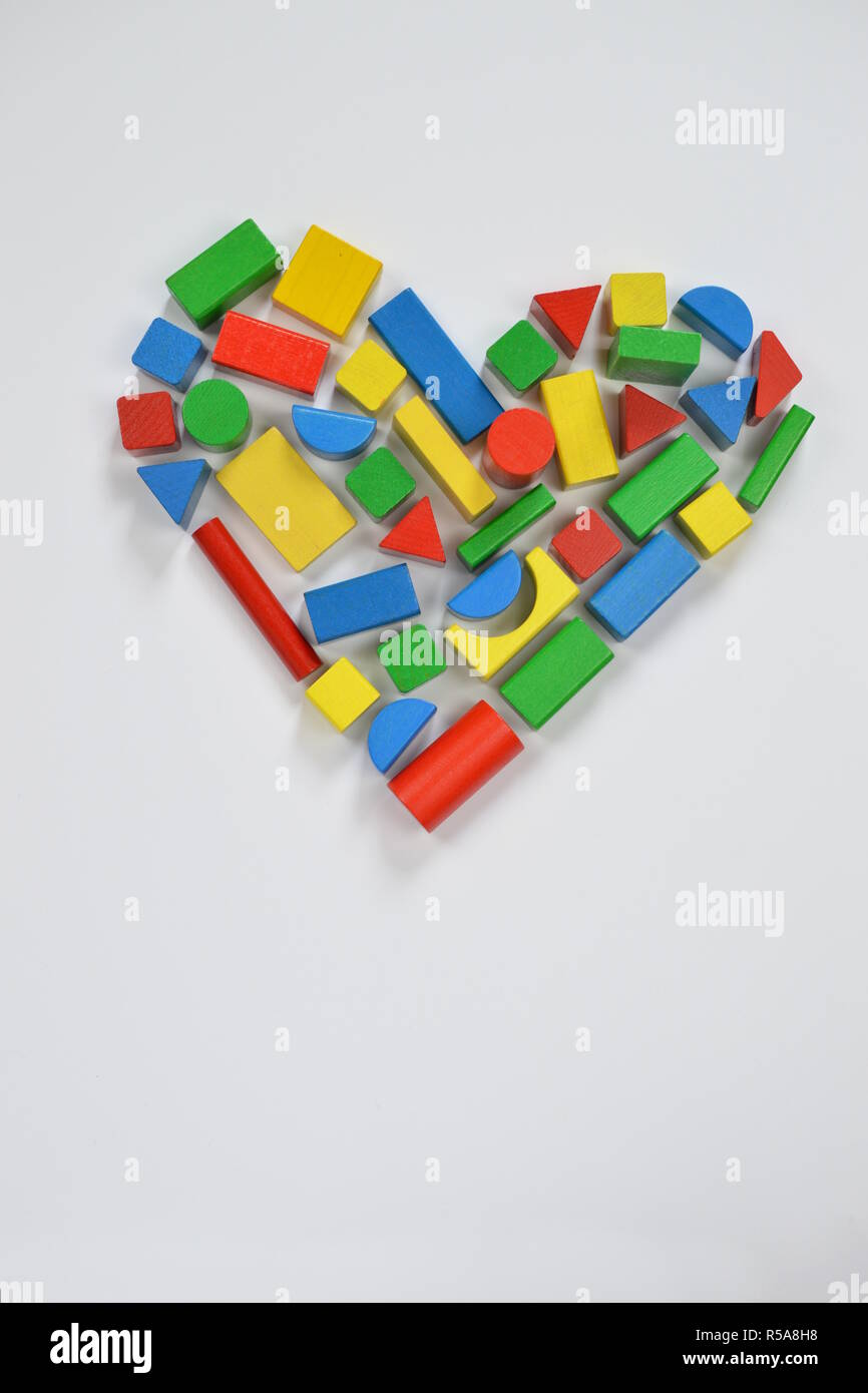 a heart composed of colorful wooden blocks Stock Photo