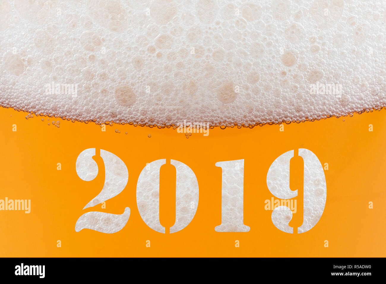 happy new year 2019 inscription on a glass of beer stock image