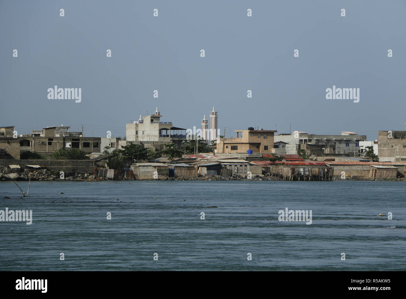 Lagune de Cotonou, a little river from lake Nokoue to the Ocean. Many activities at the water, fishermen, boats - Stock Image