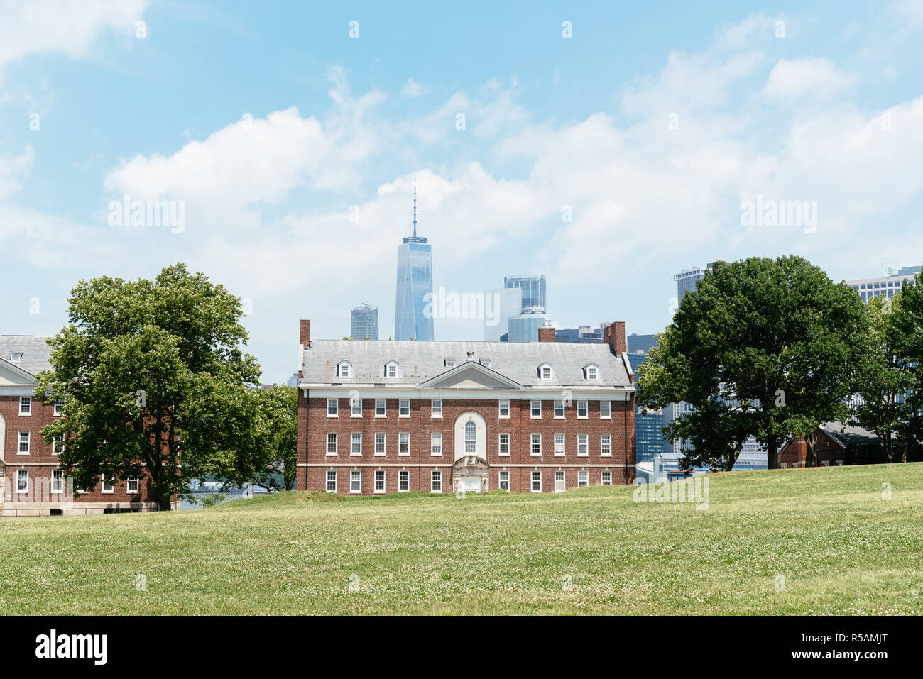 New York City, USA - June 24, 2018: Fort Jay in Governors Island against Downtown cityscape, it is a coastal star fort on Governors Island in New York - Stock Image