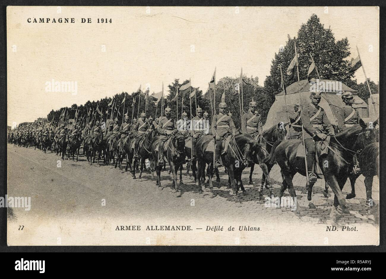 'Campagne de 1914 - Armee Allemande - defile de uhlans.' A postcard dated 28 December 1914, sent to a French address. the picture shows a line of German Uhlans (lancers). 28-Dec-14. Source: Pte.coll.pstcard 6 (private collection). Language: French. - Stock Image