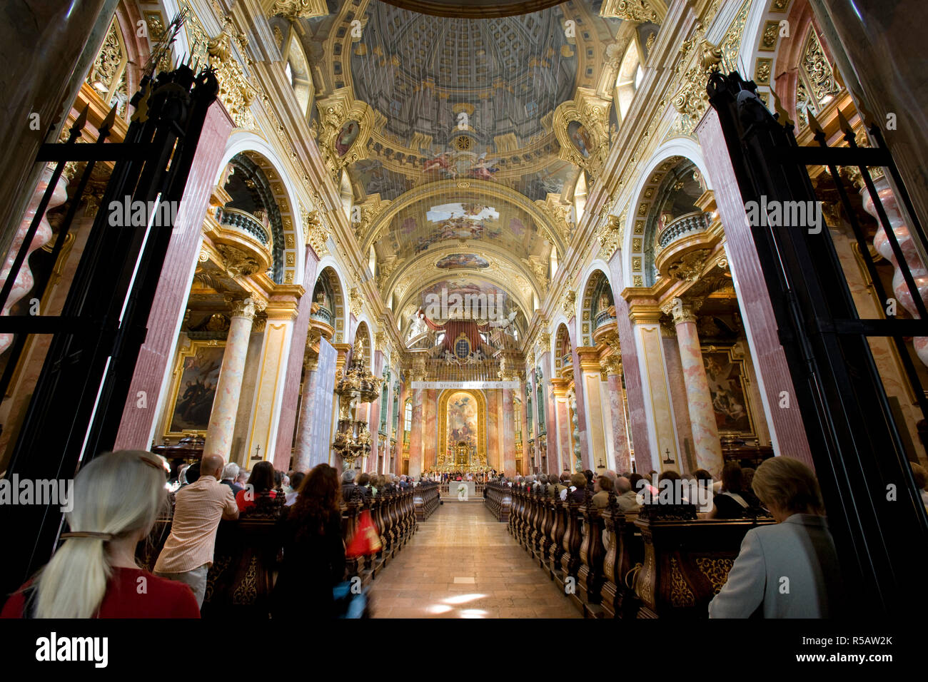 Congregation inside the 17thC Jesuit Church, Vienna, Austria - Stock Image