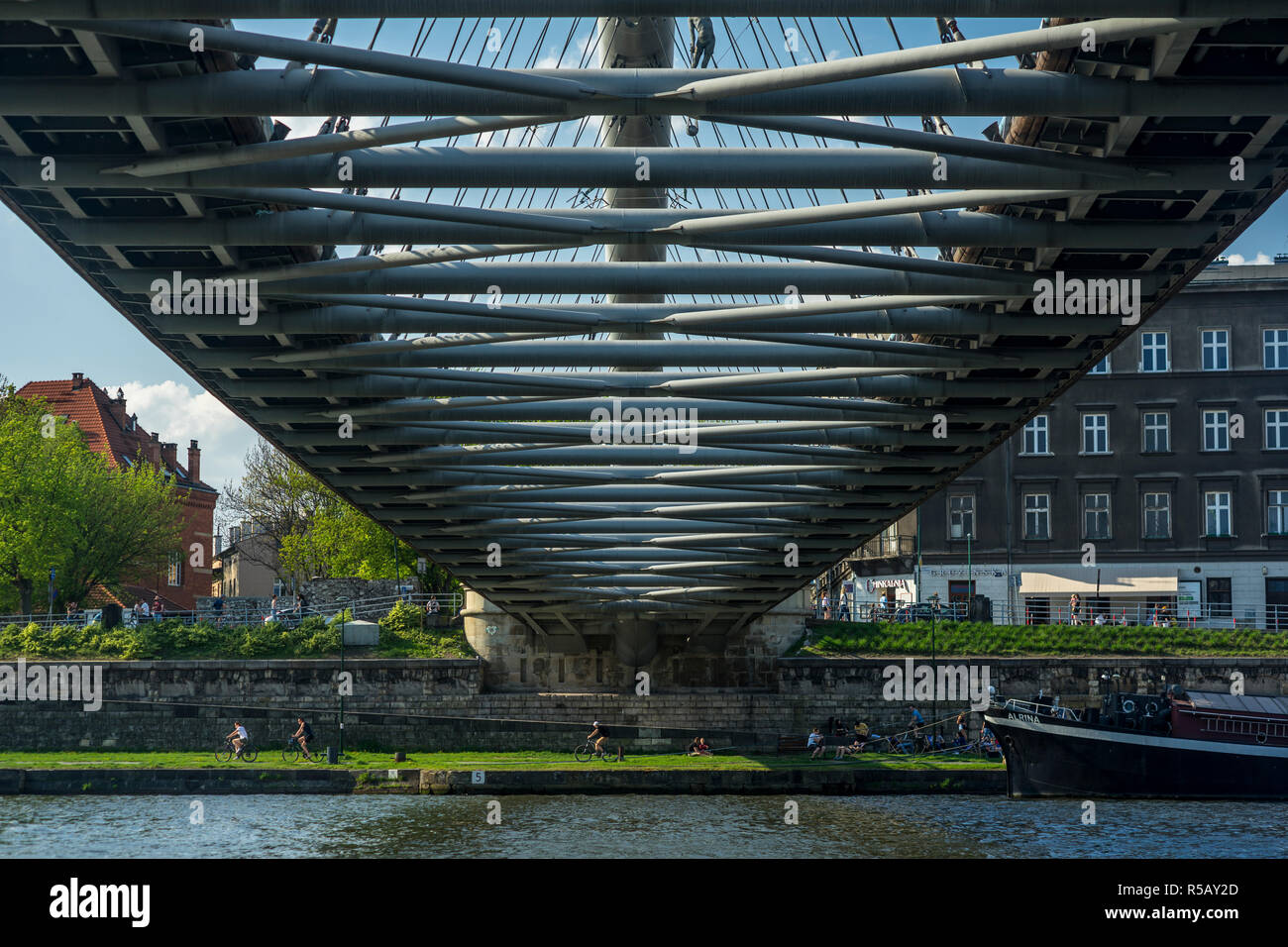 The Father Bernatek Footbridge connects the districts of Kazimierz and Podgórze with each other, Kraków, Poland Stock Photo