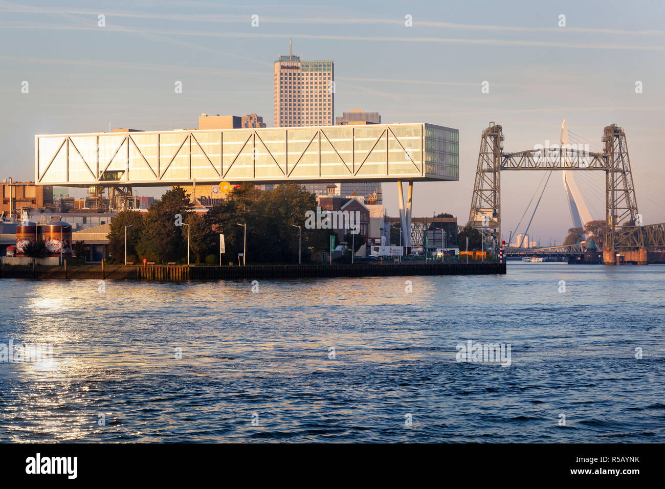 Rotterdam, Netherlands – October 5, 2018: Unilever building Rotterdam with bridge De Hef and the Erasmus bridge in the background - Stock Image