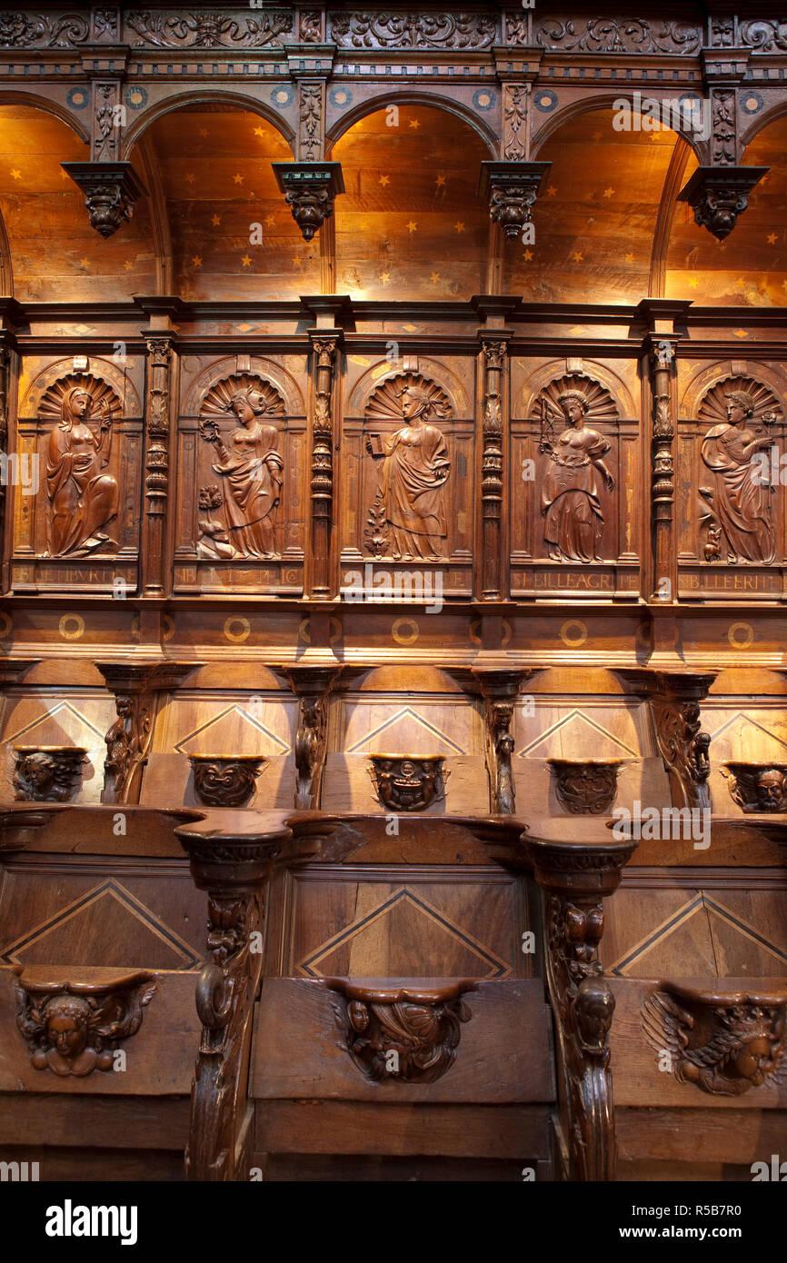 Central Choir carved stalls, St Bertrand De Comminges, Haute-Garonne, Pyrenees, France - Stock Image