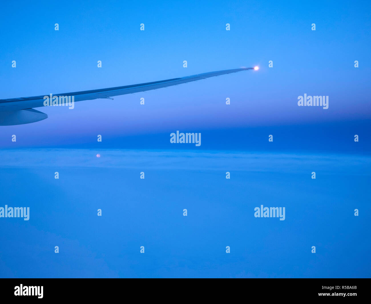 Moonrise during a flight - Stock Image