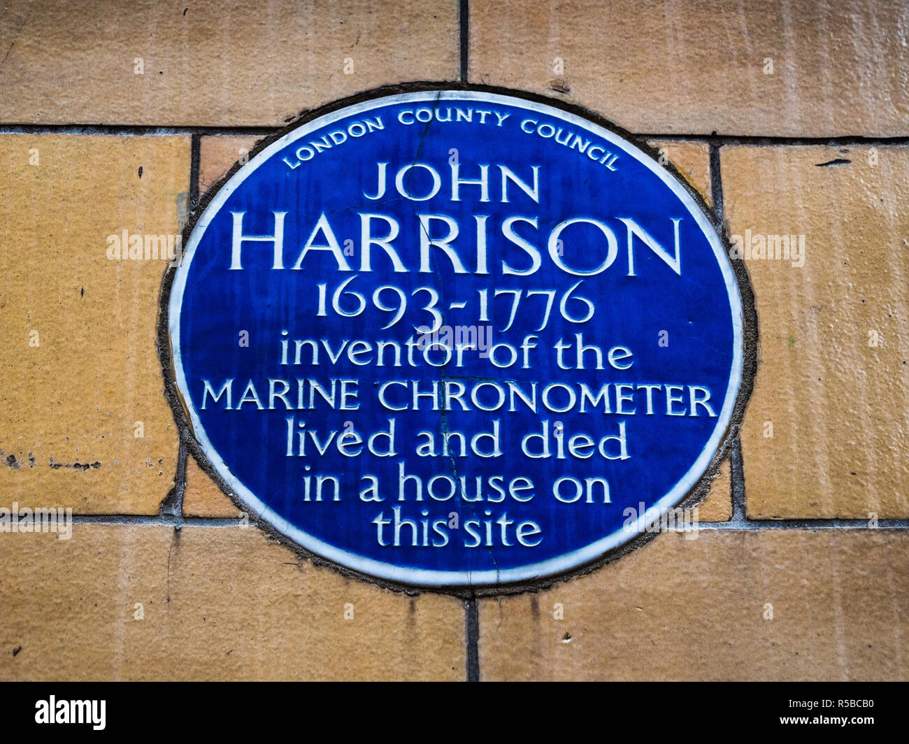 John Harrison Blue Plaque London - John Harrison invented the marine chronometer. Plaque on the house in Summit House, Red Lion Square, Holborn London - Stock Image