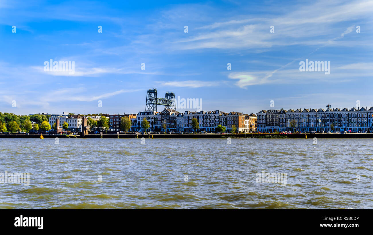 The Nieuwe Maas river with the historic houses on the shore of Noorder eiland in the center of the harbor city of Rotterdam in the Netherlands - Stock Image