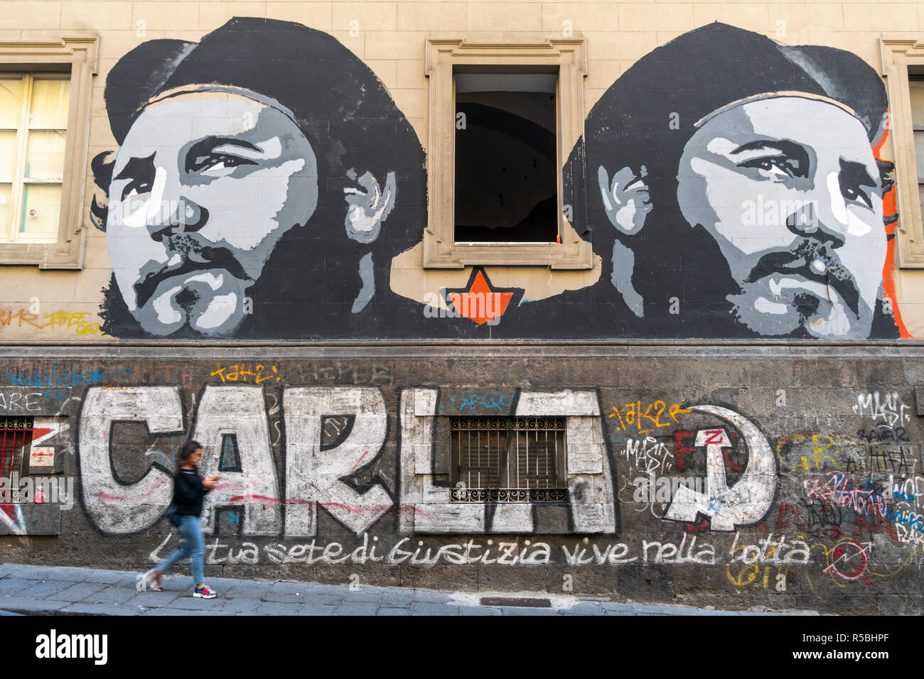 Street art with a communist leaning depicting Fidel Castro, on a building in the Via Mezzocannone, in the 'Centro Storico',  Historic Center of Naples - Stock Image