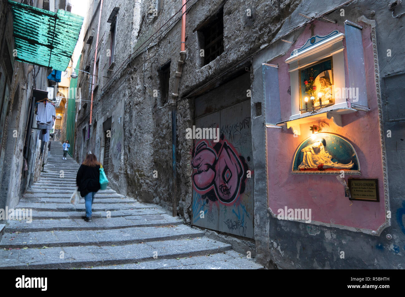 A typical family shrine found in many streets in Naples like this one in the Pendino Santa Barbara, leading up to the Centro Storico, the  historical  - Stock Image