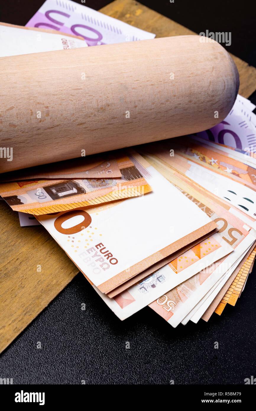Baseball bat with money. Corruption extortion concept Stock Photo