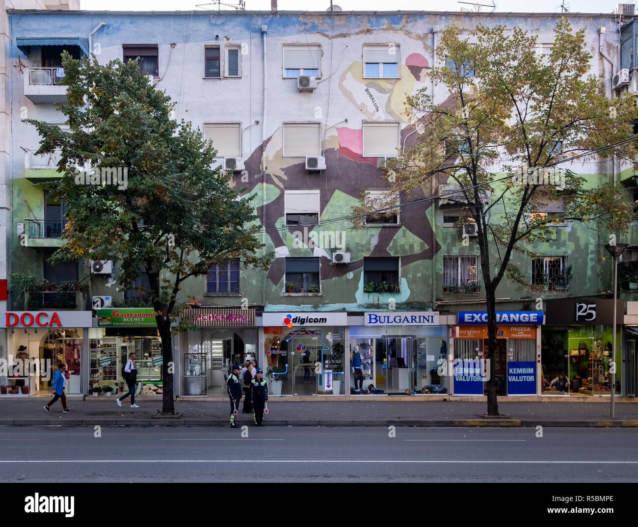The painted facades of apartment building  by residents in colorful fashion the make city more happy.  Rare Design of a horse.  Trafic Police. - Stock Image