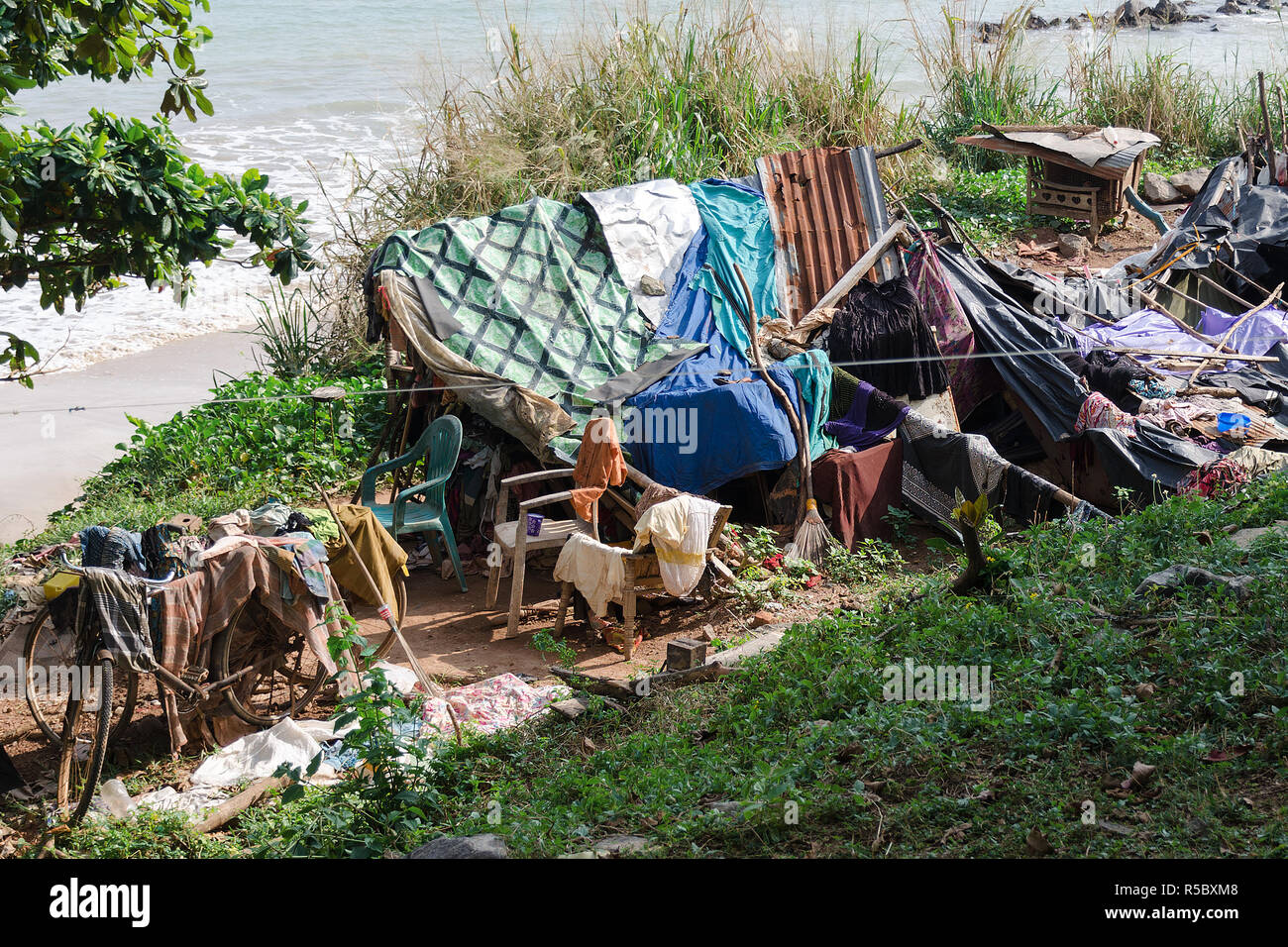 Place to stay and for life of homeless people, near sea beach. Concept of poverty and deprivation, social problems with housing shortage. - Stock Image