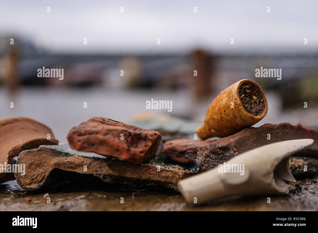 Close up of an old broken clay pipe from the past, found while mudlarking on the River Thames in London, England Stock Photo