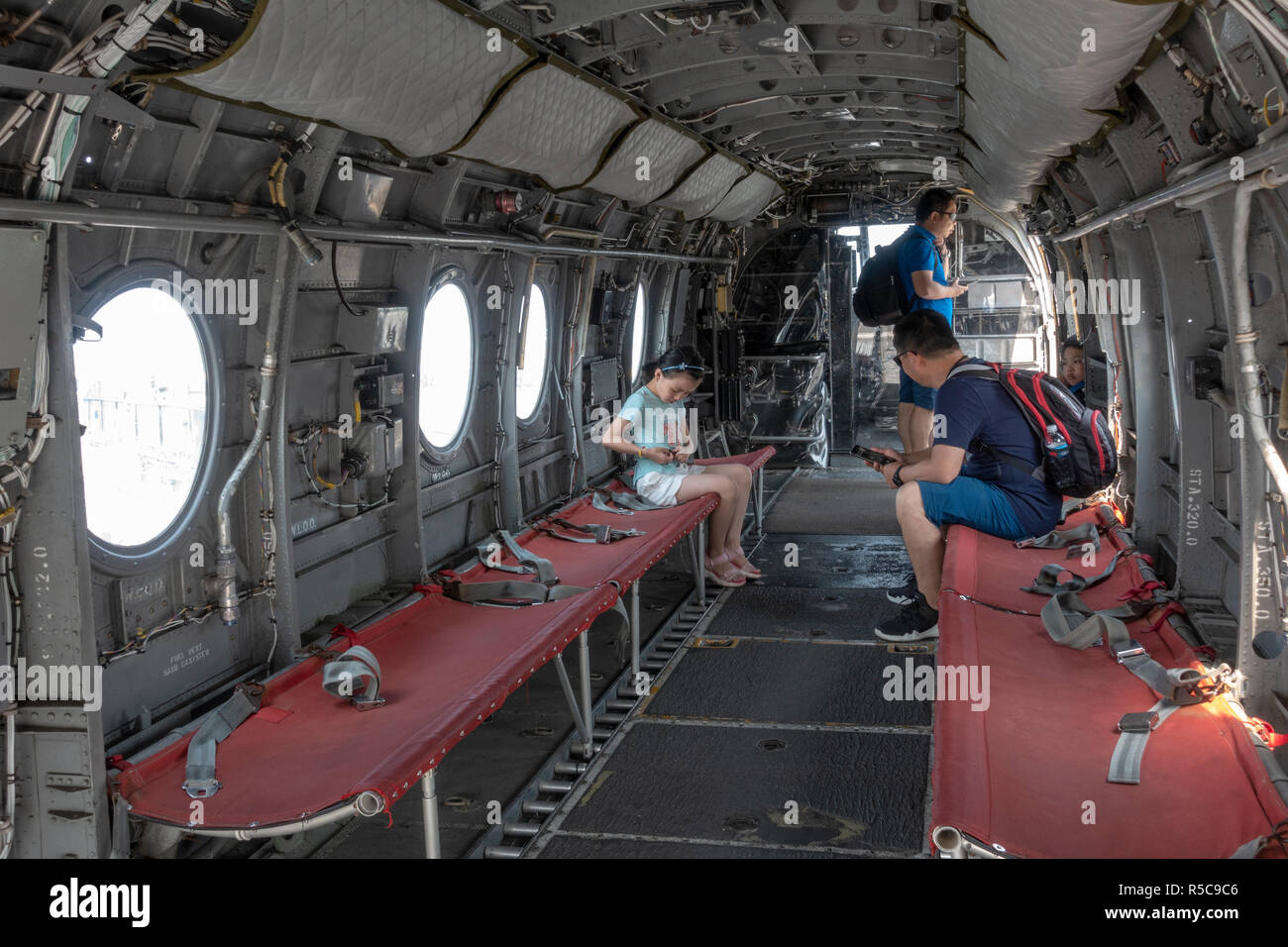 Inside view of seating of a CH-46 Sea Knight helicopter, USS Midway, San Diego, California, United States. - Stock Image