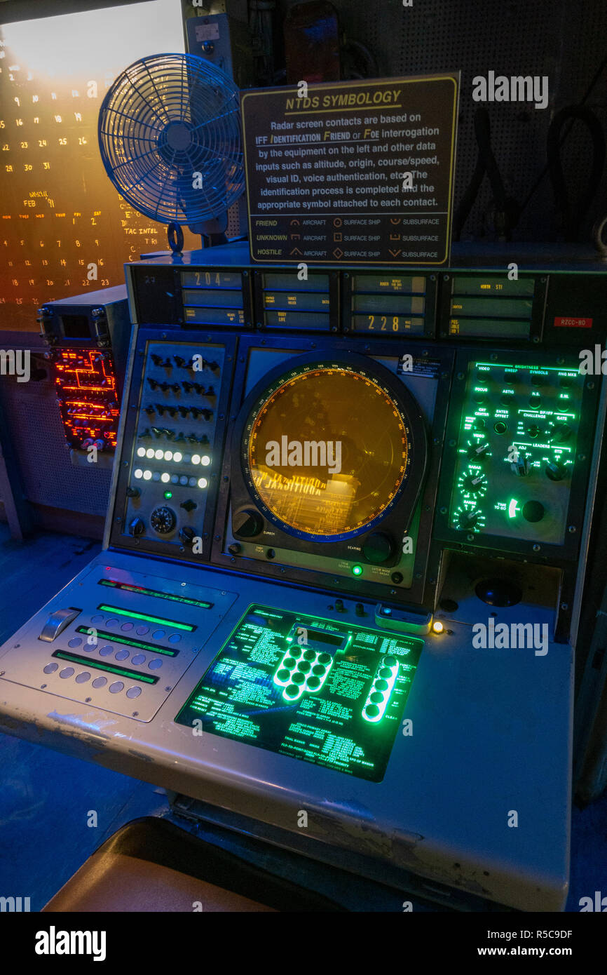 A NTDS (Naval Tactical Data System) radar screen and console, USS Midway, San Diego, California, United States. - Stock Image