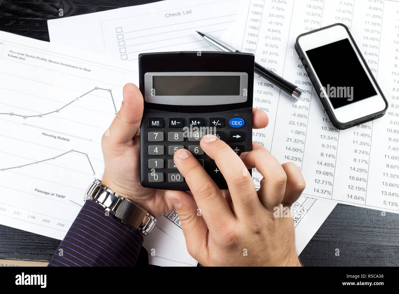 Calculator Watch Stock Photos Images Alamy Circuitry Of An Electronic Royalty Free Photography Young Businessman Using Smartphone Elegant Pen In The Office Formal Outfit With