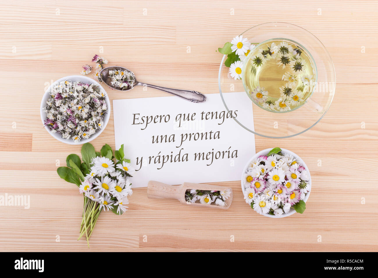 Card for recovery with tea and daisies and spanish text: I