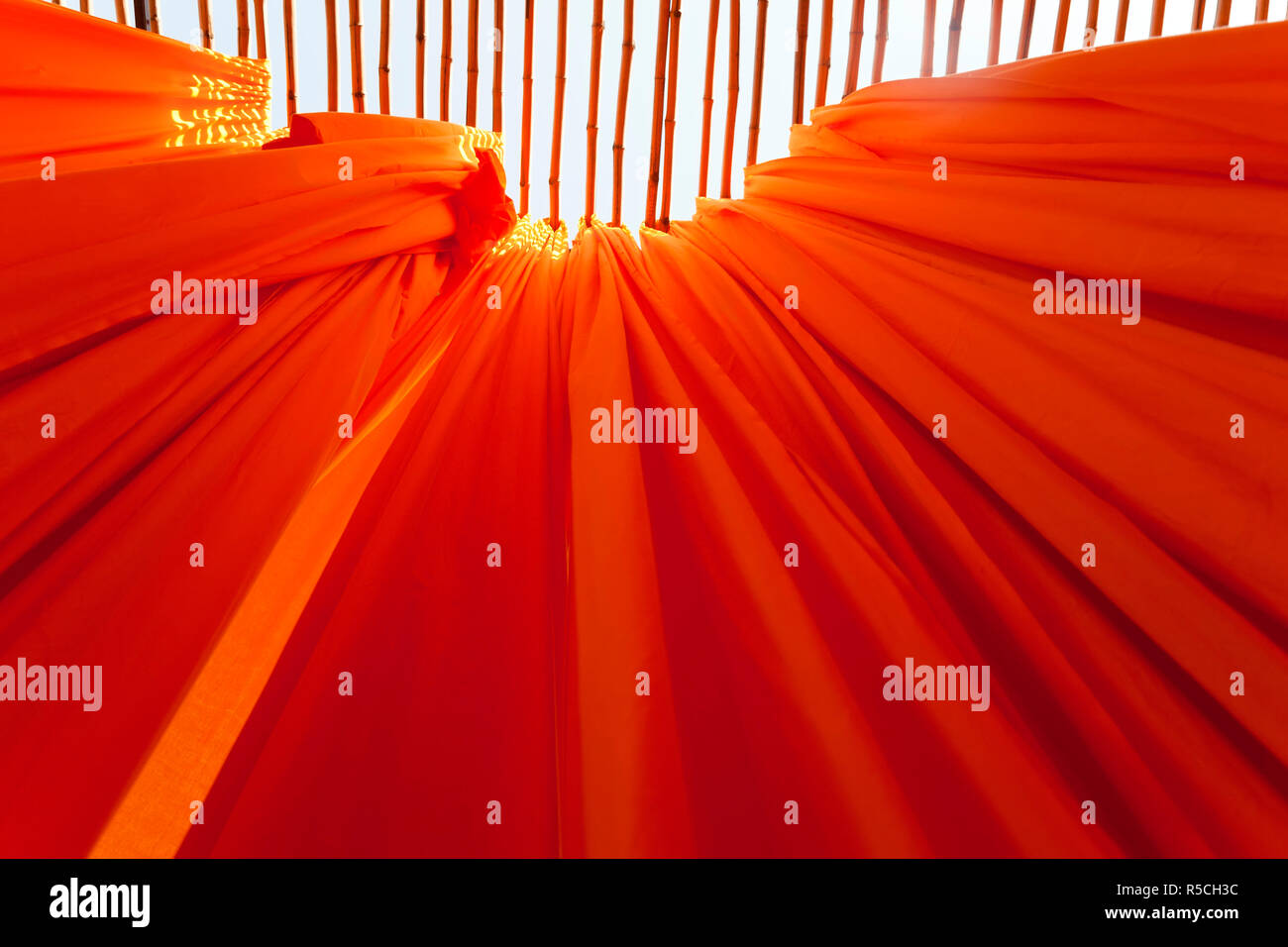 Newly dyed fabric hanging from Bamboo poles to dry, Sari garment factory, Rajasthan, India, (PR) Stock Photo
