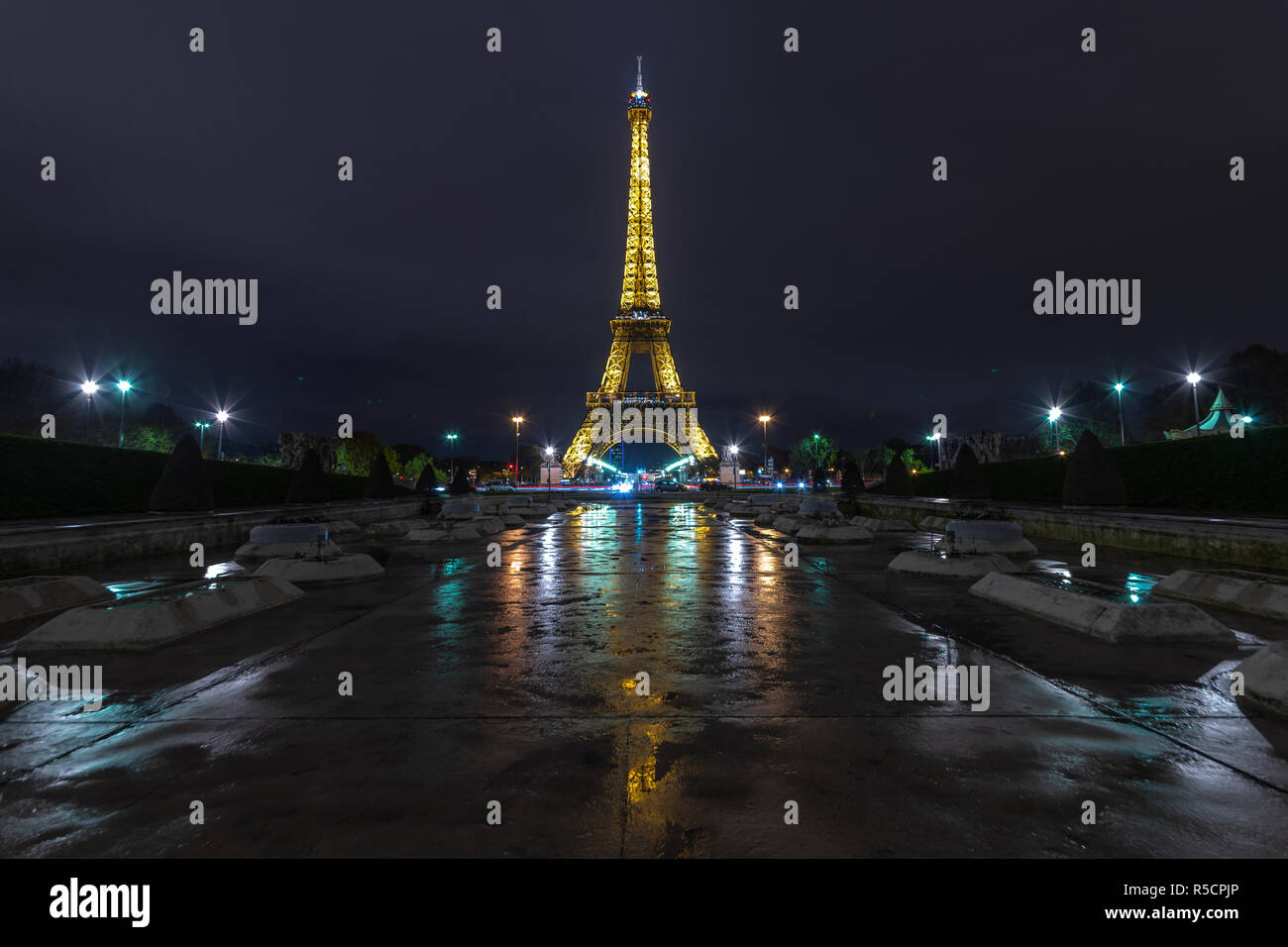 PARIS, 28 November 2018 - Illuminated Eiffel tower reflection on the Trocadero fountain water in Paris, one of the most visited building by the touris Stock Photo