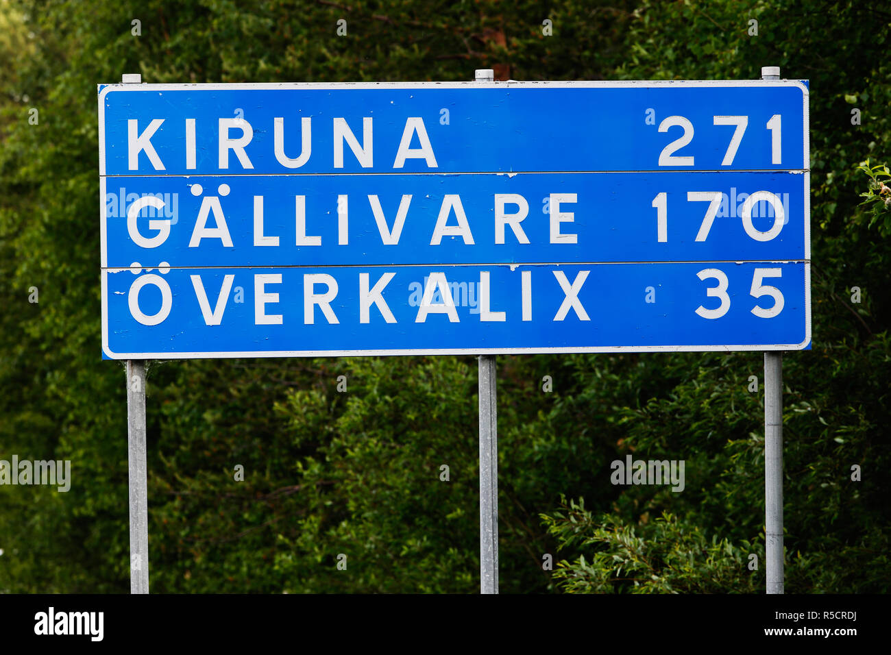 Road sign with distances to the Swedish towns Kiruna, Gallevare and Overkalix located in the northern part of the country. - Stock Image