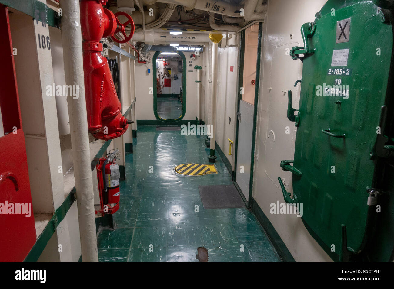 General view of below decks corridor on board the USS Midway Museum, San Diego, California, United States. Stock Photo