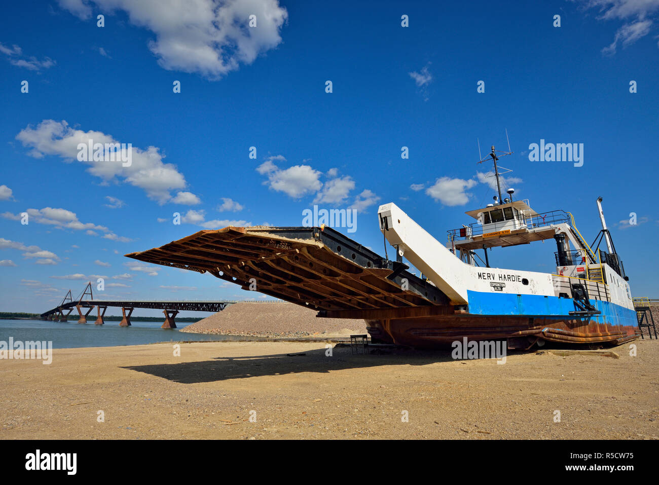 Derelict MacKenzie River ferry- The Merv Hardie, Fort Providence, Northwest Territories, Canada - Stock Image