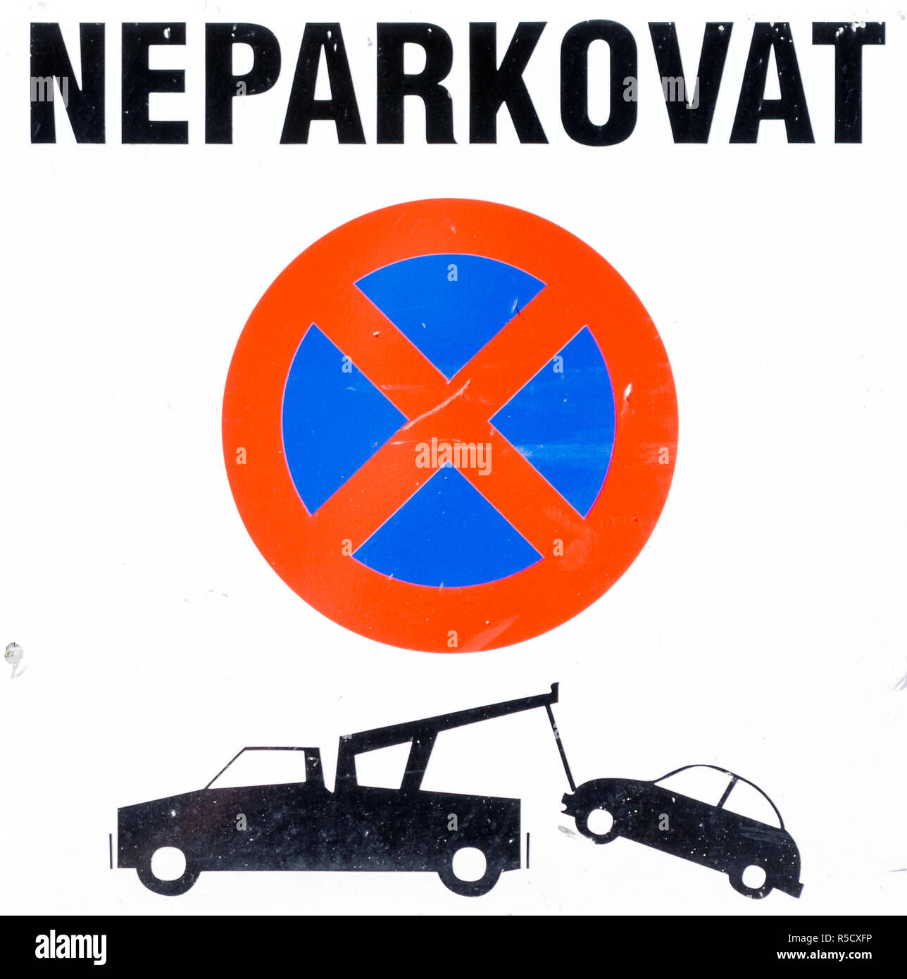 Czechian No Parking sign, cutout, showing a car being towed by a truck - Stock Image