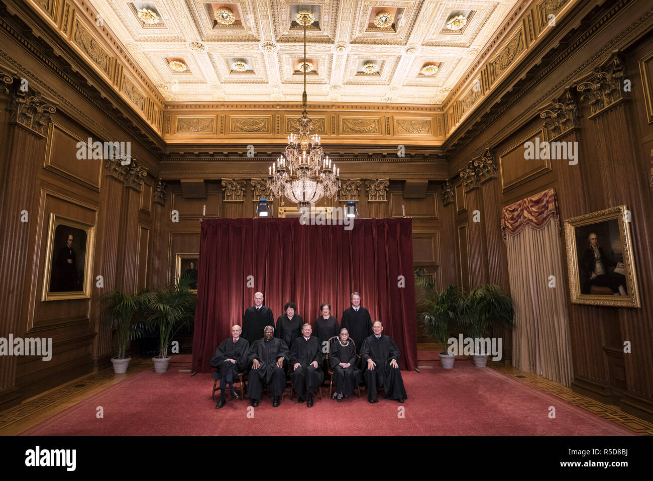 Washington, District of Columbia, USA. 30th Nov, 2018. The Supreme Court Justices pose for their official group portrait in the Supreme Court on November 30, 2018 in Washington, DC Seated from left: Associate Justice Stephen Breyer, Associate Justice Clarence Thomas, Chief Justice John G. Roberts, Associate Justice Ruth Bader Ginsburg and Associate Justice Samuel Alito, Jr. Standing behind from left: Associate Justice Neil Gorsuch, Associate Justice Sonia Sotomayor, Associate Justice Elena Kagan and Associate Justice Brett M. Kavanaugh Credit: Kevin Dietsch/CNP/ZUMA Wire/Alamy Live News - Stock Image