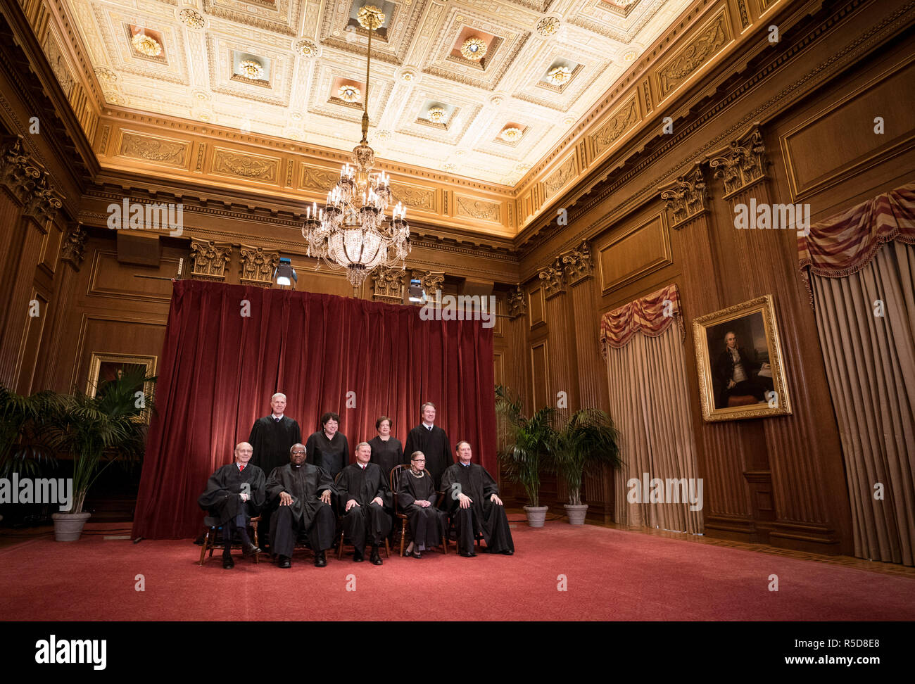 The Supreme Court Justices pose for their official group portrait in the Supreme Court on November 30, 2018 in Washington, DC Seated from left: Associate Justice Stephen Breyer, Associate Justice Clarence Thomas, Chief Justice John G. Roberts, Associate Justice Ruth Bader Ginsburg and Associate Justice Samuel Alito, Jr. Standing behind from left: Associate Justice Neil Gorsuch, Associate Justice Sonia Sotomayor, Associate Justice Elena Kagan and Associate Justice Brett M. Kavanaugh. Credit: Kevin Dietsch/Pool via CNP | usage worldwide - Stock Image