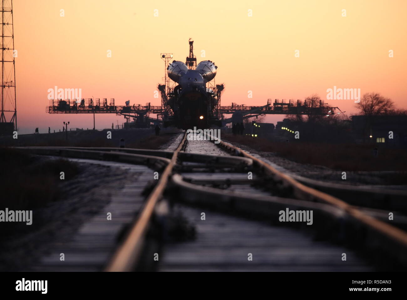 Kazakhstan. 01st Dec, 2018. KAZAKHSTAN - DECEMBER 1, 2018: A Soyuz-FG rocket booster carrying the Soyuz MS-11 spacecraft being transported from an assembling facility to a launch pad at the Baikonur Cosmodrome at dawn. The launch of the Soyuz MS-11 spacecraft crew of Roscosmos cosmonaut Oleg Kononenko, NASA astronaut Anne McClain, and Canadian Space Agency (CSA) astronaut David Saint-Jacques to the International Space Station (ISS) is scheduled for December 3, 2018 at 14:31 Moscow time. Sergei Savostyanov/TASS Credit: ITAR-TASS News Agency/Alamy Live News - Stock Image