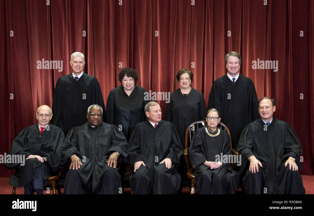 Washington, USA, 30 November 2018. The Supreme Court Justices pose for their official group portrait. Seated from left: Associate Justice Stephen Breyer, Associate Justice Clarence Thomas, Chief Justice John G. Roberts, Associate Justice Ruth Bader Ginsburg and Associate Justice Samuel Alito, Jr. Standing behind from left: Associate Justice Neil Gorsuch, Associate Justice Sonia Sotomayor, Associate Justice Elena Kagan and Associate Justice Brett M. Kavanaugh. Credit: Kevin Dietsch/CNP/ZUMA Wire/Alamy Live News - Stock Image