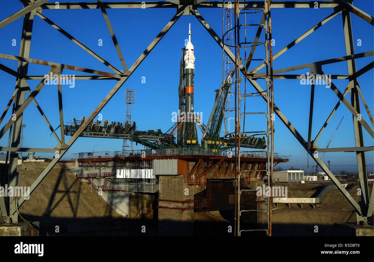 Kazakhstan. 01st Dec, 2018. KAZAKHSTAN - DECEMBER 1, 2018: A Soyuz-FG rocket booster carrying the Soyuz MS-11 spacecraft is installed on the launch pad at the Baikonur Cosmodrome. The launch of the Soyuz MS-11 spacecraft crew of Roscosmos cosmonaut Oleg Kononenko, NASA astronaut Anne McClain, and Canadian Space Agency (CSA) astronaut David Saint-Jacques to the International Space Station (ISS) is scheduled for December 3, 2018 at 14:31 Moscow time. Valery Sharifulin/TASS Credit: ITAR-TASS News Agency/Alamy Live News - Stock Image