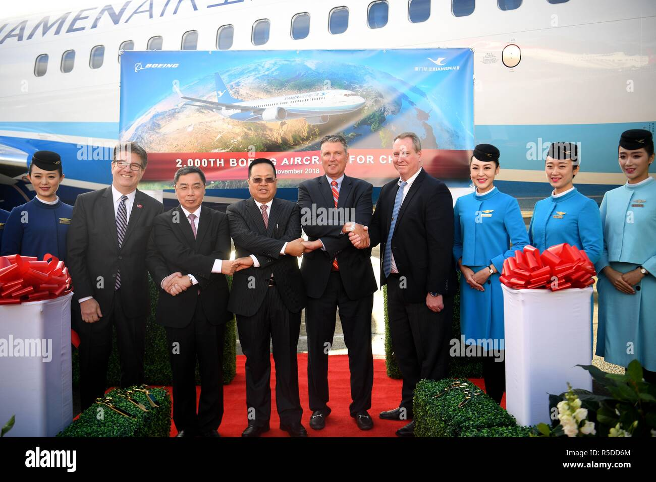 Seattle, Boeing airplane to China in Seattle. 30th Nov, 2018. Guests attend the ribbon-cutting ceremony during the delivering of the 2,000th Boeing airplane to China in Seattle, the United States on Nov. 30, 2018. Top U.S. aircraft manufacturer Boeing Company on Friday delivered its 2,000th airplane to China, which is a milestone for the U.S. aircraft maker in the world's largest commercial aviation market. Credit: Wu Xiaoling/Xinhua/Alamy Live News - Stock Image