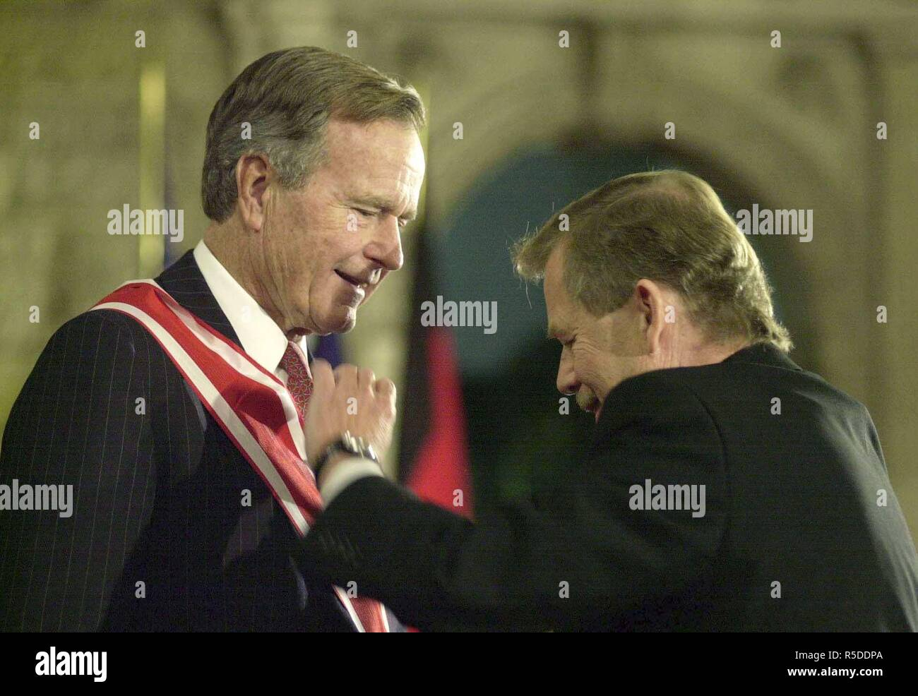 FILE PHOTO George Bush receiving The White Lion Order from the