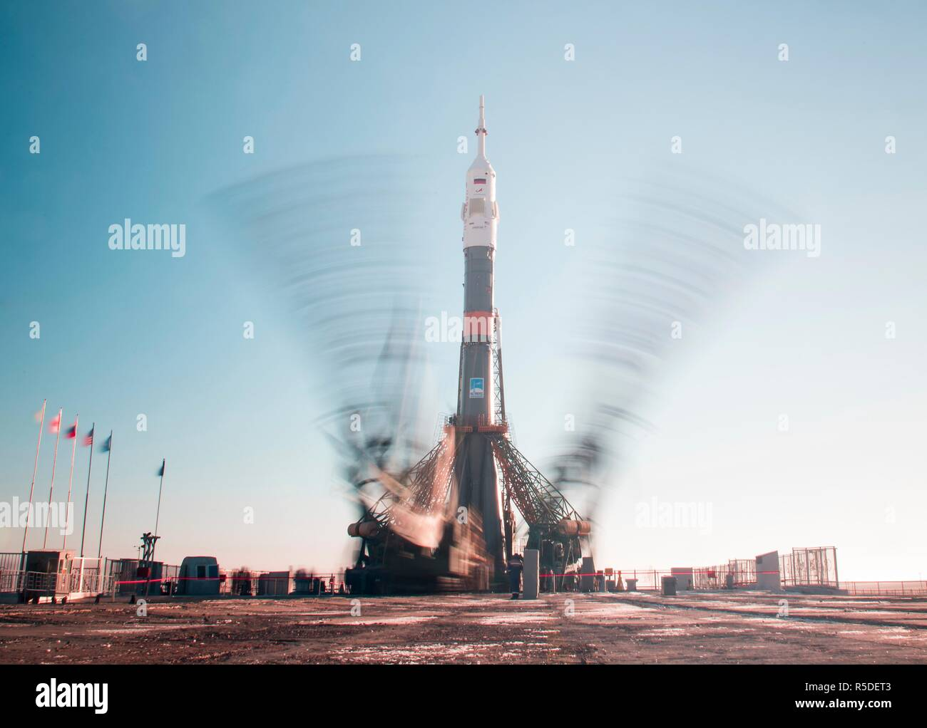 Baikonur, Kazakhstan, 1st December 2018. The Soyuz booster rocket and MS-11 spacecraft is upright on the launch pad as the gantry arms begin to close early morning at the Baikonur Cosmodrome December 1, 2018 in Baikonur, Kazakhstan. The rocket will carry Expedition 58 crew members Russian Oleg Kononenko of Roscosmos, American Anne McClain and Canadian David Saint-Jacques to the International Space Station on December 3rd. Credit: Planetpix/Alamy Live News - Stock Image