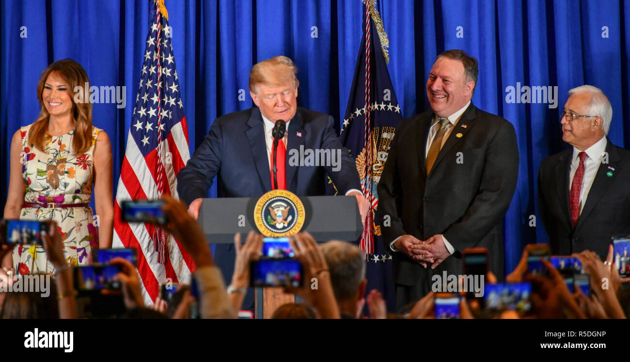 Buenos Aires, Argentina. 1st December, 2018. Argentina. 1st December 2018. Buenos Aires, Argentina. 30th November 2018. U.S. President Donald Trump, center, delivers remarks alongside First Lady Melania Trump and Secretary of State Mike Pompeo, right, during a meet and greet with staff and families of US Embassy November 30, 2018 in Buenos Aires, Argentina. 30th November 2018 Credit: Planetpix/Alamy Live News Credit: Planetpix/Alamy Live News - Stock Image