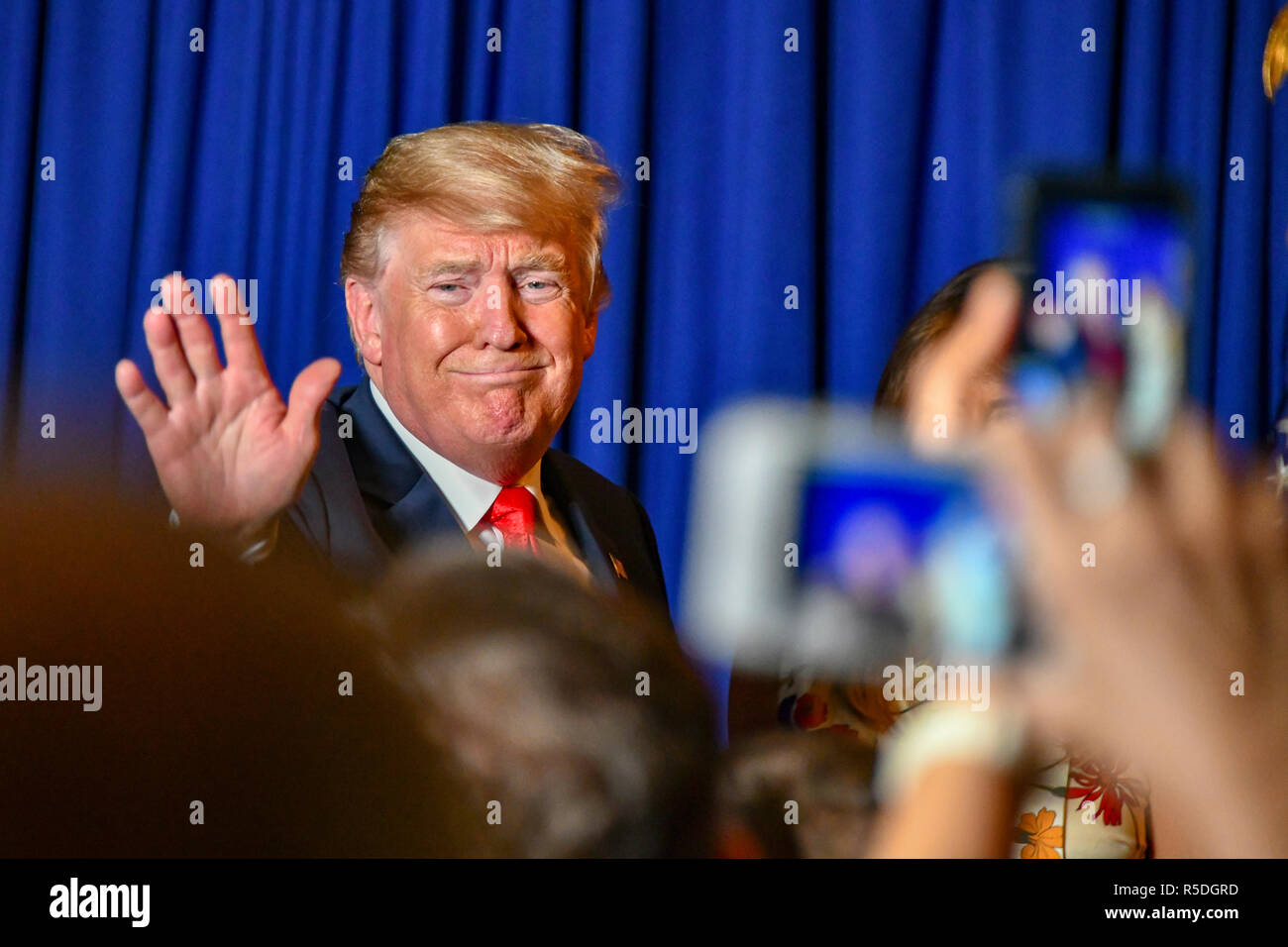 Buenos Aires, Argentina. 1st December, 2018. Argentina. 1st December 2018. Buenos Aires, Argentina. 30th November 2018. U.S. President Donald Trump, waves during a meet and greet with staff and families of US Embassy November 30, 2018 in Buenos Aires, Argentina. 30th November 2018 Credit: Planetpix/Alamy Live News Credit: Planetpix/Alamy Live News - Stock Image