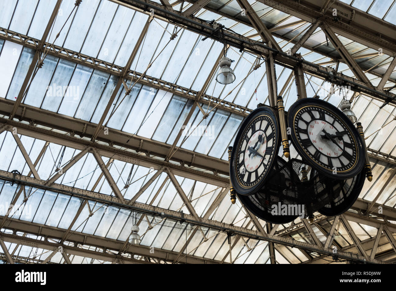 Clock in railway station departure hall. - Stock Image