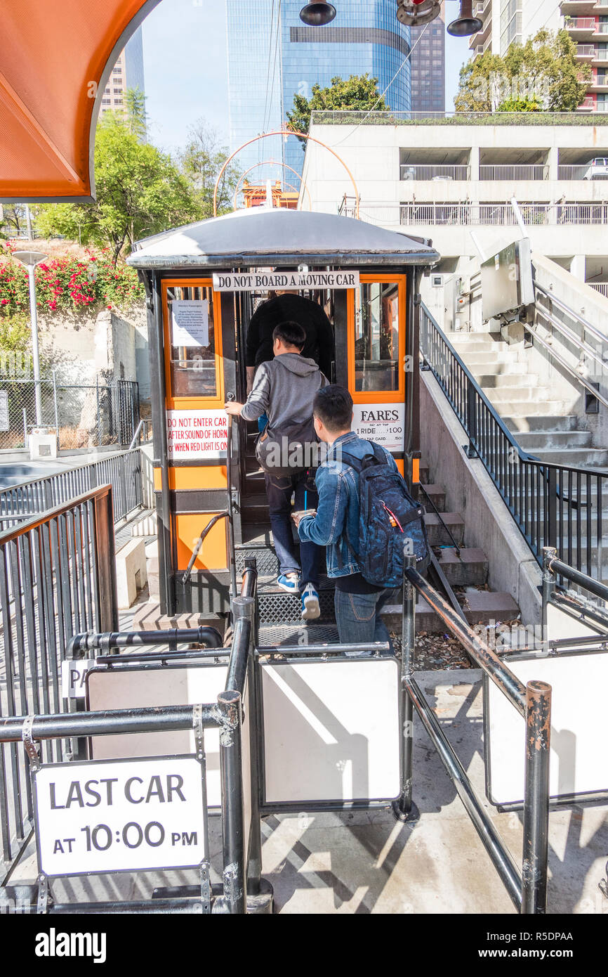 Hill Street loading area for Angel's Flight with people getting in the funicular. Angels Flight is a landmark narrow gauge funicular railway in LA. - Stock Image