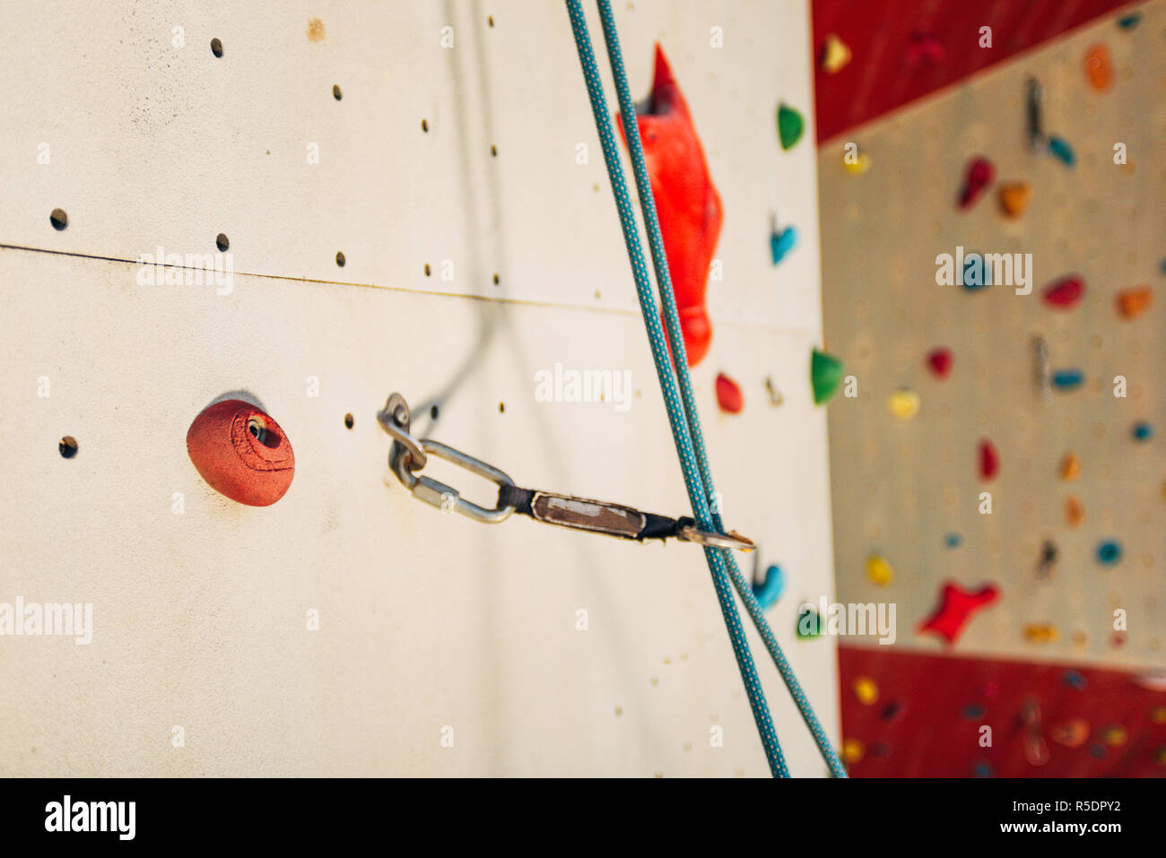 Outdoor rock climbing wall in a sport facility - Stock Image