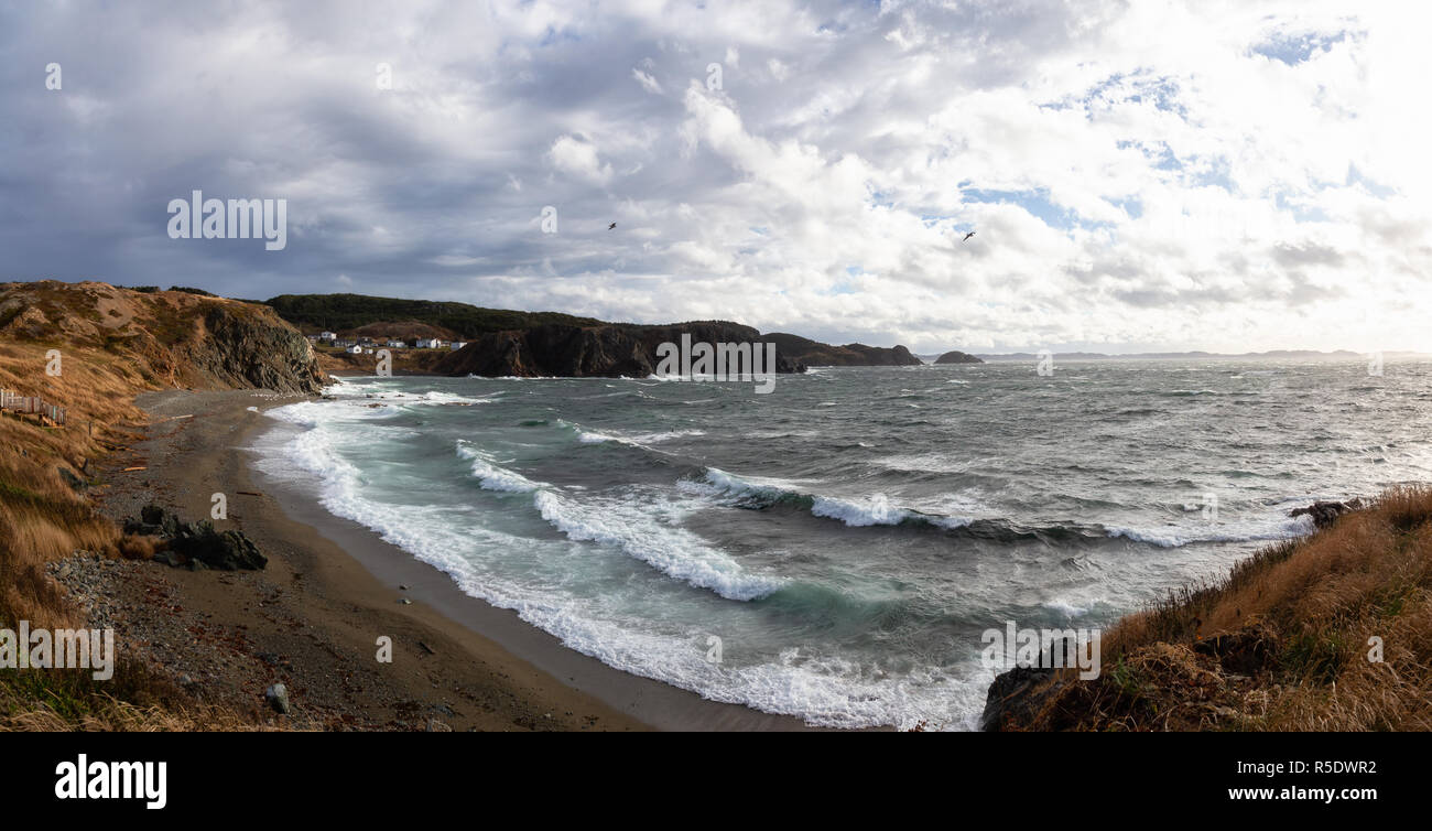 Panoramic view of a raging ocean on the Atlantic Coast during a stormy and windy day. Taken in Crow Head, North Twillingate Island, Newfoundland and L Stock Photo