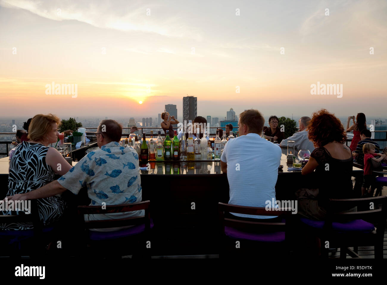 Open air-bar 'Sirocco Sky Bar' and Bangkok in the evening, State Tower, 247 m, The Dome, Bangkok, Thailand - Stock Image