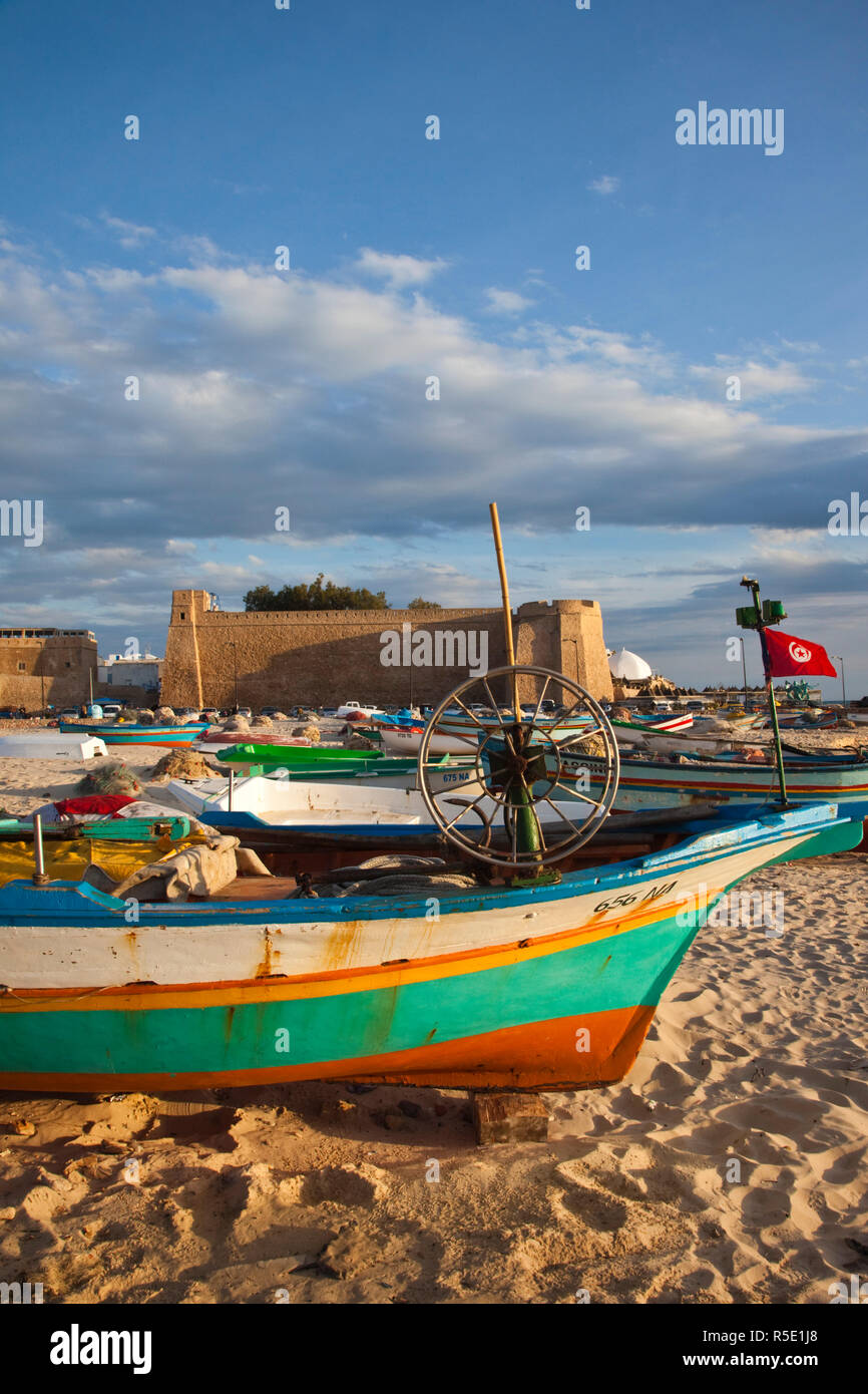 Tunisia, Cap Bon, Hammamet, waterfront, Kasbah Fort and fishing boats - Stock Image