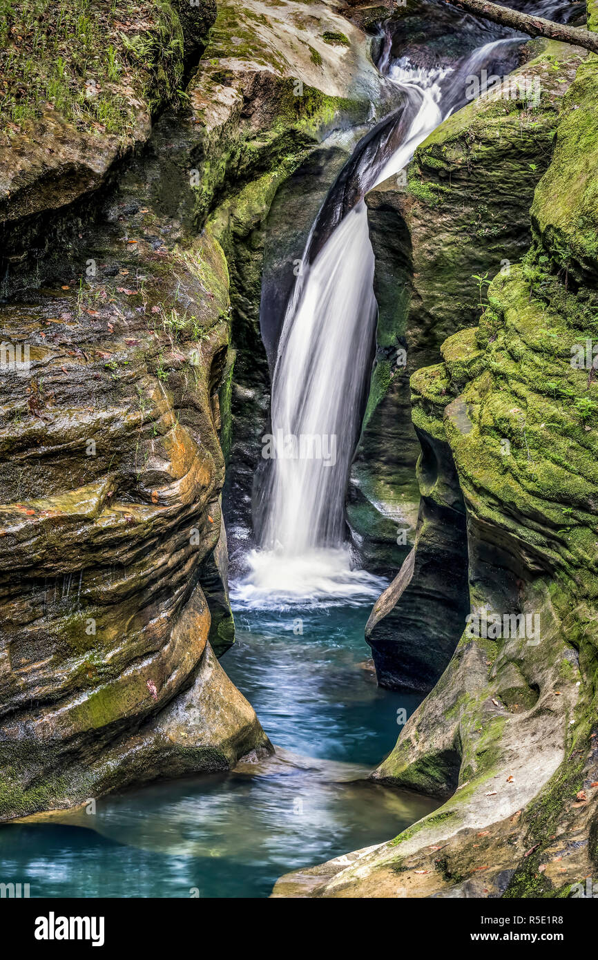"Robinson Falls, sometimes called ""Corkscrew Falls,"" is a slender waterfall plunging into a rocky ravine  in the beautiful Hocking Hills of Ohio. Stock Photo"